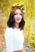 Portrait young girl with flower wreath — Stock Photo