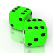 Green dices on white — Stock Photo