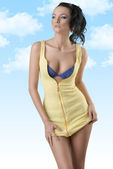 Sexy brunette with unzipped dress looks at right — Stock Photo