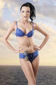 Pretty brunette in bikini with funny expression — Stock Photo