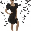 Sexy girl in halloween suit with hand on the hip - Stock Photo