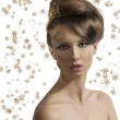Royalty-Free Stock Photo: Pretty girl with christmas decoration looks in to the lens