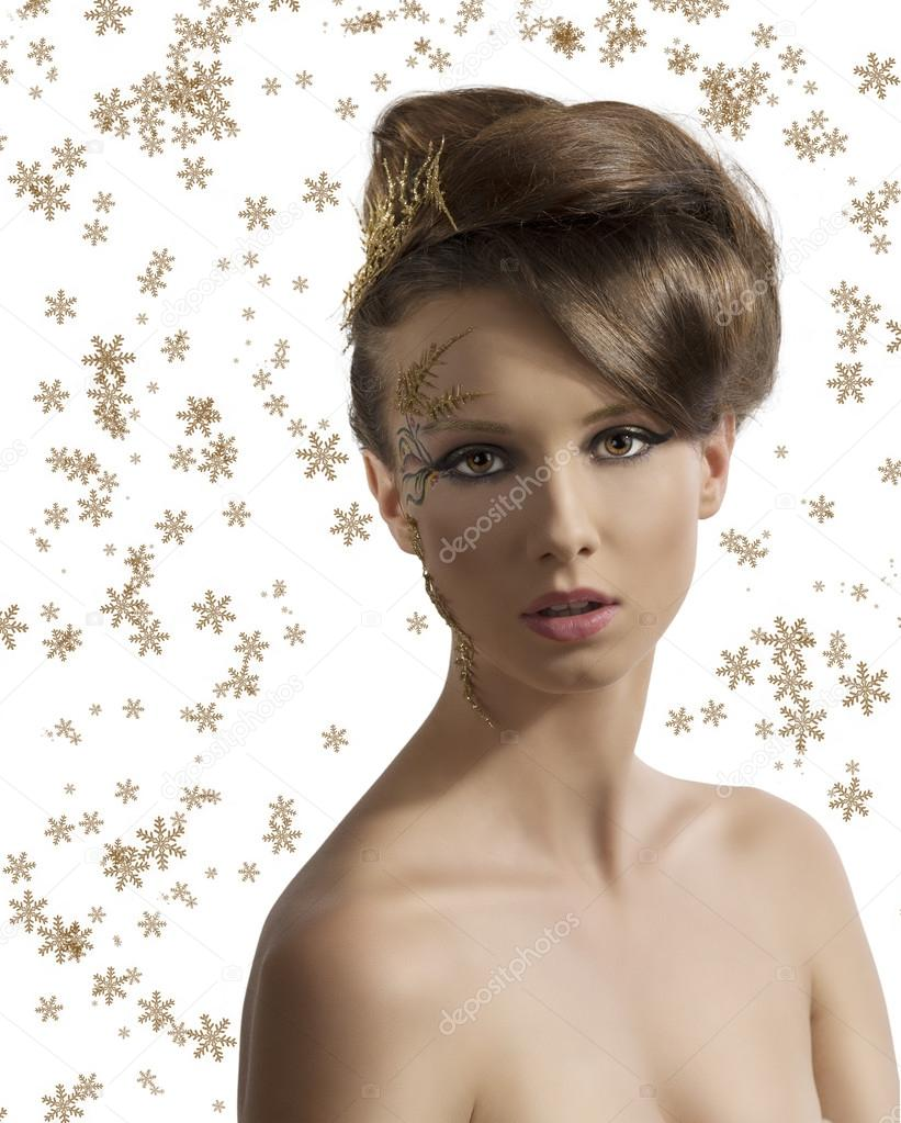 Beautiful woman with christmas make-up and hair decoration, she is in front of the camera and looks in to the lens  Stock Photo #13850619