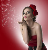 Pretty girl with red dress turned of three quarters — Stock Photo