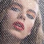 ������, ������: Portrait of girl behind net with bent head