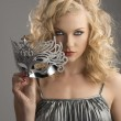 Blonde girl with silver mask in front of the camera - Lizenzfreies Foto