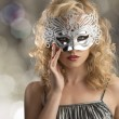 Blonde girl with silver mask on the face — Stock Photo