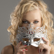 Blonde girl with silver mask looks in to the lens — Stock Photo