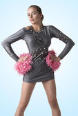 Sexy cheerleader with pompom on the hips — Stock Photo