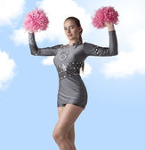 Sexy cheerleader raises pompom — Stock Photo