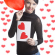 Pretty brunette with valentine postcard and balloon — Stok fotoğraf