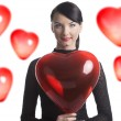 Pretty brunette with heart shaped balloon in front of the camera — Stock Photo