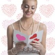 Blonde girl takes a valentine postcard — Stock Photo