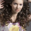 Pretty brunette with curly hair smiles — Stock Photo #20140661
