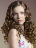 Pretty brunette with curly hair — Stock Photo