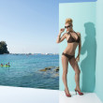 Постер, плакат: Woman in bikini with sunglasses in sensual pose
