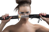 Brunette in japan style with katana in front of the face — Stock Photo