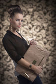 Fashion brunette with bag turned of three quarters — Stock Photo