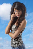 Sexy brunette with casual clothing turned of three quarters — Stock Photo