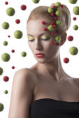 Girl with colored spheres on the face — Stock Photo