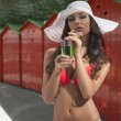 Sensual girl in swimsuit near red cabana - Foto de Stock  