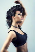 Woman creative hair-style and motion blur effect — Stock Photo