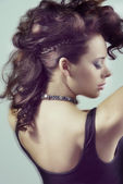 Close-up of girl with fashion hairstyle moving blur effect — Stock Photo