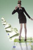 Elegant business woman on eoro trampoline — Stock Photo