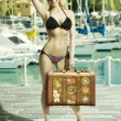 Stock Photo: Happy girl with bikini and bag