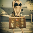Pretty girl ready to travel waiting for the ship — Stock Photo #25588911