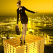 Worried business woman on gold tower and town — Stock Photo #26057085
