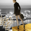 Stock Photo: Nice business woman on gold tower near sea port