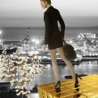 Nice business woman on gold tower near sea port — Stock Photo #26099257
