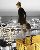 Nice business woman on gold tower near sea port — Stock Photo