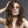 Sexy young woman with curly hair — Stock Photo #26149917