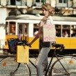Sexy woman shopping in bicycle - ストック写真