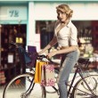 Vintage sexy girl shopping with bicycle — Stock Photo