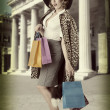 Sexy kitsch girl with  shopping bag vintage — Stock Photo