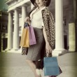 Sexy kitsch girl with shopping bag vintage — Stock Photo #26893441