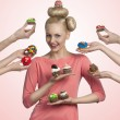 Pretty girl with many colorful cupcakes — Stock Photo