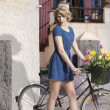 Sexy blonde girl with bicycle — Stock Photo #27218967