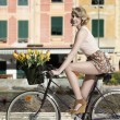 Smiling woman on bicycle outdoor sea — Foto de Stock