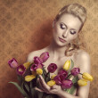 Blonde taking colourful bouquet vintage — Stock Photo