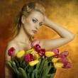 Sexy woman with colourful flowers — Stock Photo