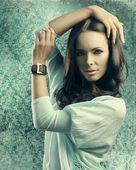 Sensual girl with smooth hair near old fashion wallpapaper — Stock Photo