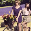 Stock Photo: Sexy vintage girls with bicycle