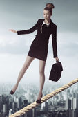 Business woman in unstable balance — Stock Photo