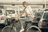 Eco-friendly girl on a bicycle — Stock Photo