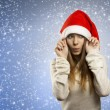Adorable girl with santa claus hat — Stock Photo