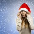 Adorable girl with santa claus hat — Stock Photo #34398315